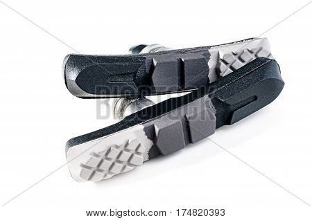 Cycle brake pads from composite material on white background