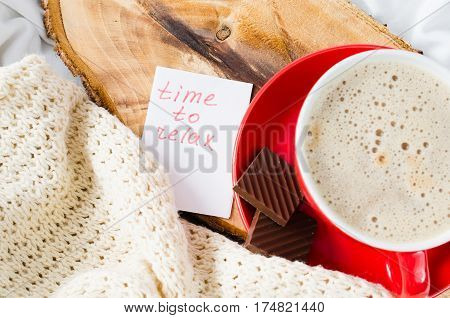 Cup of Hot Cappuccino and Chocolate in the Bed Notes Time to Relax Lazy Morning. Selective Focus.