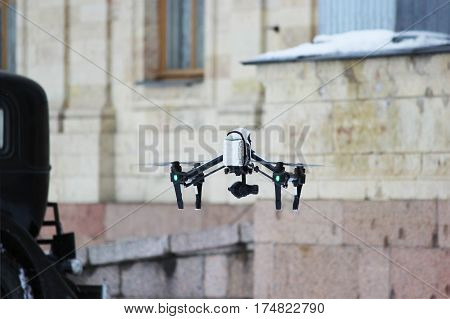 the operator removes the historical film using quadrocopters on the background of old cars and Gatchina Palace.