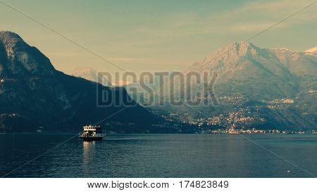 Boats sailing through a mountain lake. Lake Como, Italy, February