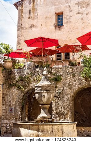 Historic building with fountain in the old village St. Paul-de-Vence.
