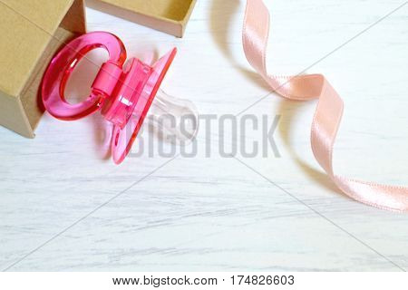Pink baby soother in the gift box