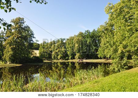 Idyllic pond and trees in chateau park in Cesky Krumlov Czech republic