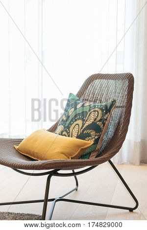 Cosy net made chair with yellow cushion