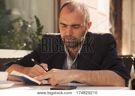 businessman planning his workday. Time management concept. (Freedom freelance success money)