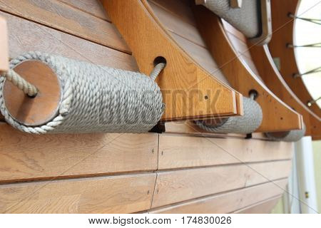 Decorative coil of rope on the background of wooden boards