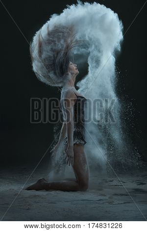 Woman makes dust with her hair she is in agony.