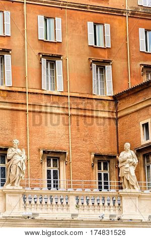 Vatican City Vatican City State - June 10 2016: The Apostolic Palace official residence of the Pope also known as the Papal Palace. The building contains the Papal apartment and various offices of the Catholic Church.