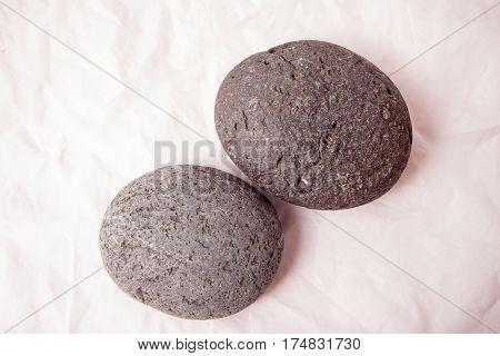 Lava rocks in the studio on white background.