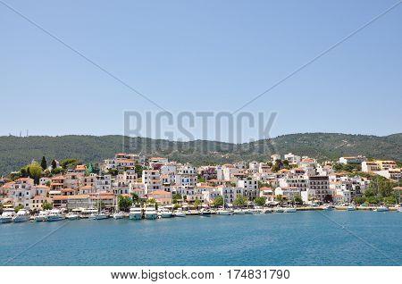 Skopelos island seaside coastline town with buildings typical greek view Greece