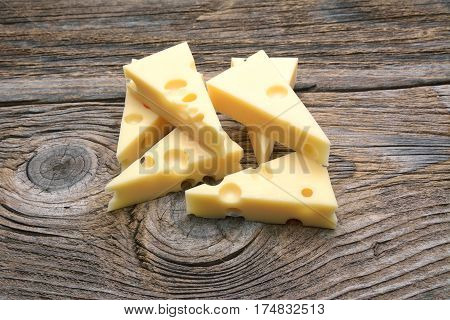 Emmental cheese on the cutting board .