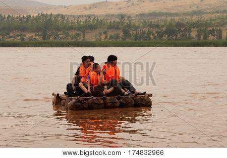 Ningxia, China - Jul 9, 2011: Tourists Floating Along The Yellow River (huang He) On A Sheepskin Raf