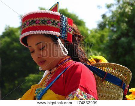 Shilin, Yunnan, China - Apr 15, 2006: Beautiful Woman Of Sani People In Colorful Traditional Costume