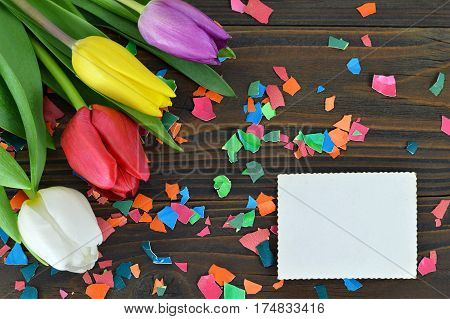 Blank Easter card Easter flowers and colored eggshell on wooden background