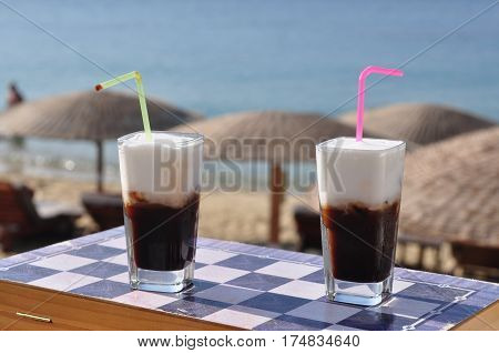 coffee drink,chess game and beach with parasol