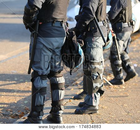 Police In Riot Gear With Protective Helmet During The Urban Revo