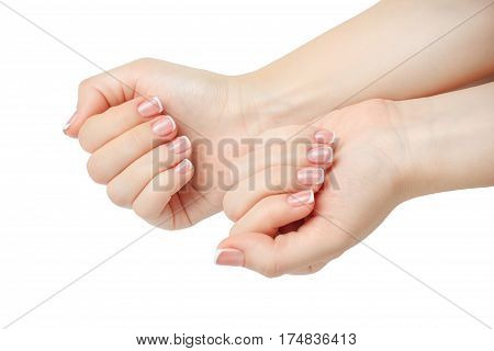 Beautiful woman's nails with beautiful french manicure isolated in white background