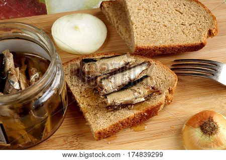 Fish sprats canned food in oil in a glass jar