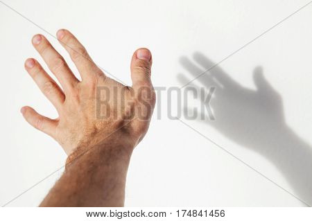Male Hand Over White Wall Background