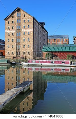 Victorian Warehouse and narrow boat in Gloucester Docks