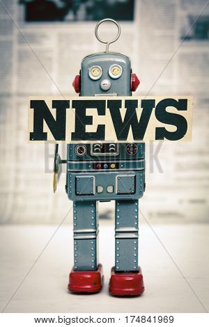 News concept with retro toy robot