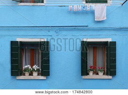 Small open windows on retro house facade