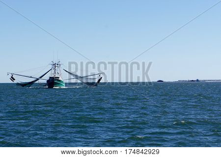 Shrimp Boat Shrimping with Nets Out in the Ocean