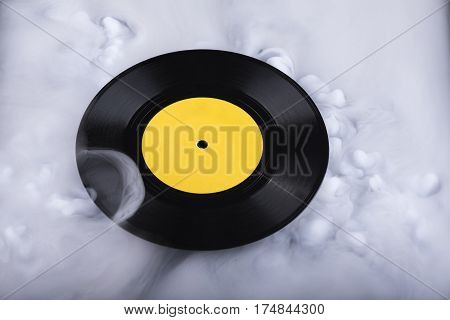 Vinyl record in clouds. Sound cloud. Conceptual image