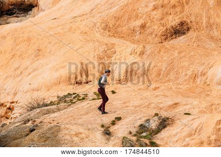 Mtiuleti Region, Georgia - May 21, 2016: Tourist Man Comes To Roadside Springs. Red Mineral Water Contains A Lot Of Iron.