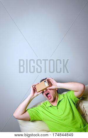 Concept of virtual reality carton glasses and interfaces. man enjoying vr glasses.