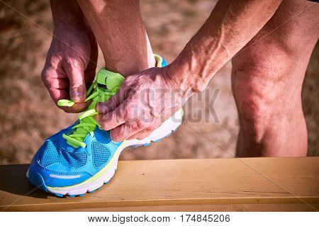 Tying shoelaces on sneakers during class outdoor sports.