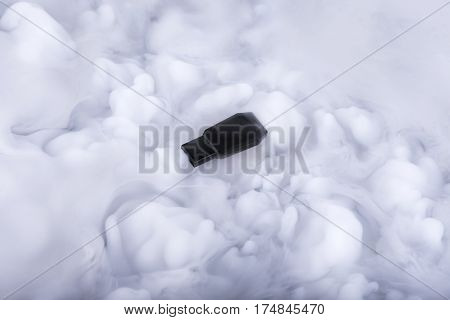 Black flash memory stick in the Information clouds