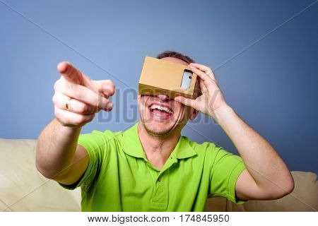 Concept of virtual reality carton glasses and interfaces. man enjoying vr glasses.