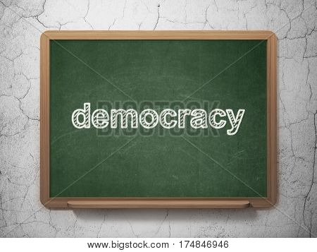 Politics concept: text Democracy on Green chalkboard on grunge wall background, 3D rendering
