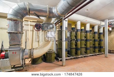 Ventilation system with air filtration facility for protection against chemical weapons in underground bomb shelter for a few thousand people. Focus on the center of the frame