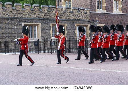 LONDON, GREAT BRITAIN - MAY 12, 2014: The Royal Guard marches on the changing of the guard at Buckingham Palace.