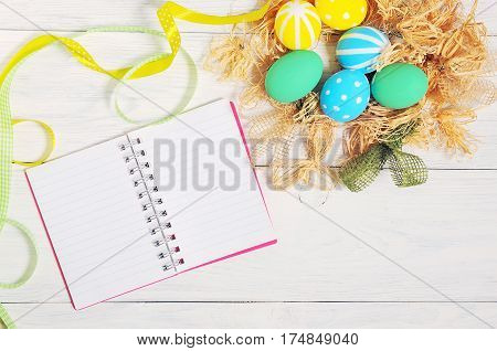 Notebook With Eco Easter Eggs In The Nest On Rustic White Background