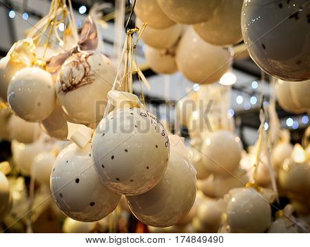 ceramic decorated Christmas balls hanging at a Christmas market