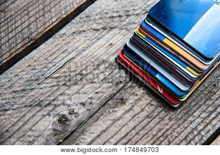credit cards stack on wooden background with copyspace