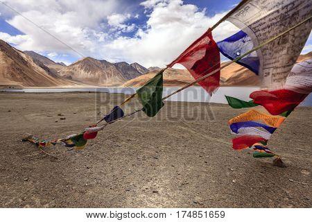 Buddhist prayer flags at Pangong Tso - alpine lake in the Himalayas on the China-India border