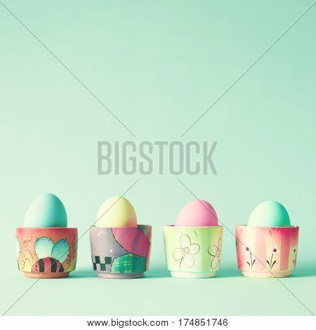 Vintage pastel Easter eggs on painted vases