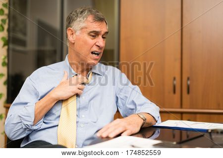 Business man sweating in his office
