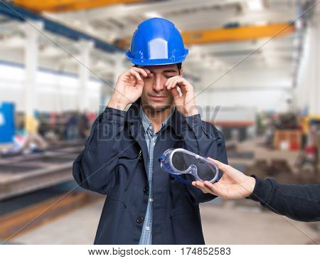 Worker suffering for a splinter in his eye