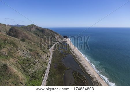Aerial view of Pacific Coast Highway and Mugu Rock north of Malibu in Ventura County, California.
