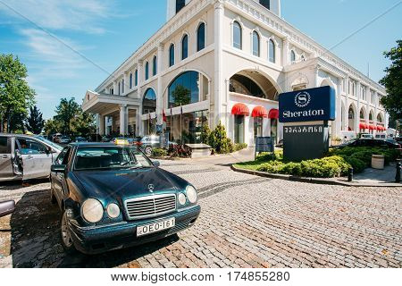 Batumi, Georgia - May 25, 2016: Mercedes Benz Taxi Car Among Parked Automobiles Near Sheraton Batumi Hotel In Sunny Summer Day