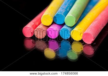 Group Of Colored Chalk To Draw Isolated On Black.