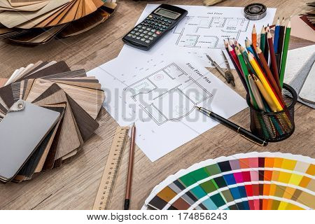 scheme plan house with a palette of colors and tools