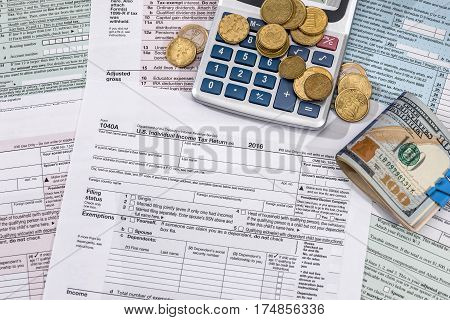 Tax Concept - Form, Money, Calculator And Pen.