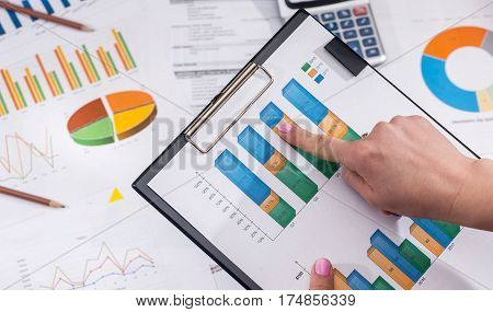 Financial Statistics Concept - Businesswoman Analytics Financial Accounting Market Chart Or Diagram.