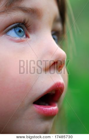 Little girl looking shocked with open mouth